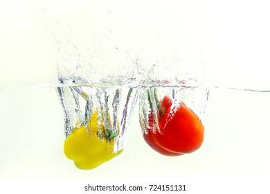 Bell pepper  falls in water .