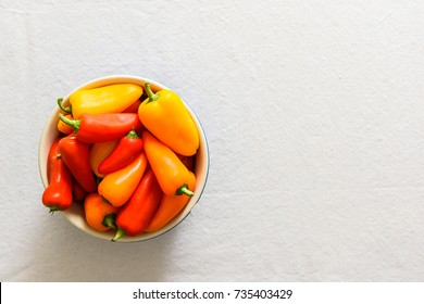 Bell peppers in bowl against a white background.