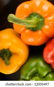 Bell Peppers on Black - Orange, Yellow, Red and Green