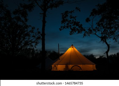 Bell tent at night, lit from within