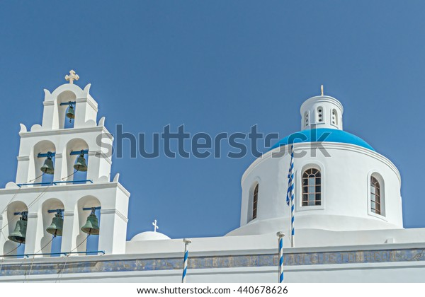 Bell tower and blue dome of Orthodox Church in Oia, Santorini, Greece