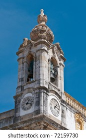 Bell Tower of the Cathedral with the clock in Faro, Portugal