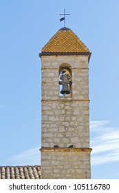 The bell tower of the cathedral. . Famous village of Saint-Paul-de-Vence is a commune in the Alps-Maritimes department in southeastern France - one of the oldest medieval towns on the French Riviera.