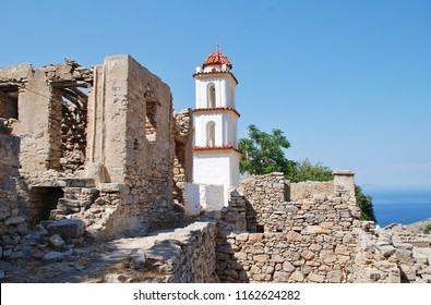 The bell tower of the church of Agia Zoni in the abandoned village of Mikro Chorio on the Greek island of Tilos.