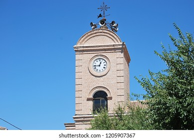 Bell tower of the church with clock embedded marking the hours. Tower or frame where the clock of the church is placed.