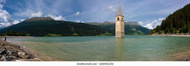 The Bell Tower of the church of Curon Venosta, appears from the Reschensee, Vinschgau, South Tyrol