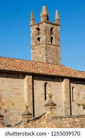 Bell tower of the church of Santa Maria Assunta (XIII century) in the ancient medieval village of Monteriggioni, Siena, Toscana (Tuscany), Italy, Europe