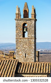 Bell tower of the Church of Santa Maria Assunta (XIII century) in the ancient medieval village of Monteriggioni, Siena, Tuscany, Italy, Europe