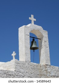 Bell tower with a cross of a greek church