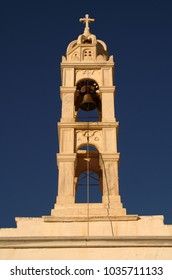 The bell tower of a Greek orthodox church at Pyrgos village, Tinos island, Cyclades, Greece.