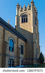 bell tower and nave wall exterior of gothic style church in saint paul minnesota