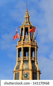 Bell tower with orange and Dutch flags, during the celebration of 'Koningsdag' (King's day) in the Netherlands.