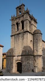 Bell tower of the parish church of Salas during summer evening, Asturias, Spain