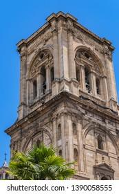 Bell tower of Roman Catholic Granada Cathedral or Cathedral of Incarnation (Catedral de Granada, Santa Iglesia Catedral Metropolitana de la Encarnacion de Granada, 1561). Granada, Andalusia, Spain.