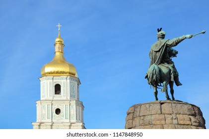 Bell tower and sculpture of the man on a horse are in the sky. Saint Sophia Cathedral and the Bohdan Khmelnytskyi monument are religious and historical landmarks of Kiev city.