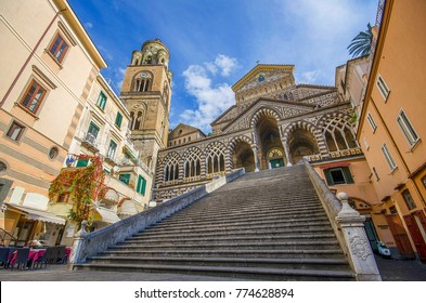 The bell tower, the stairs and central facade of Amalfi Cathedral, dedicated to the Apostle Saint Andrew, Roman Catholic cathedral in the Piazza del Duomo, Amalfi, Italy