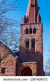 bell tower and steeple above entrance of landmark church built in richardsonian romanesque style architecture in saint paul minnesota