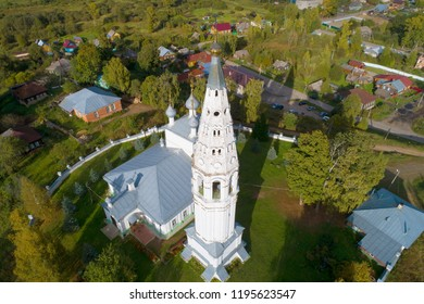 The bell tower of the Transfiguration Cathedral close up on a September afternoon (shooting from a quadrocopter). Sudislavl, Russia