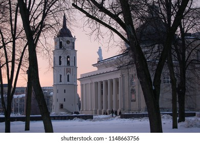 Bell tower of Vilnius Cathedral in snow at sunset