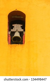 Bell tower in the yellow cathedral in San Cristobal de las Casas in Chiapas, Mexico