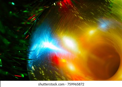 Bell of trumpet with red, blue and white highlights on  shiny Christmas tree background; toned in gold