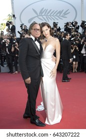Bella Hadid and Mohamed Hadid attend the 'Ismael's Ghosts' screening and Opening Gala during the 70th annual Cannes Film Festival at Palais des Festivals on May 17, 2017 in Cannes, France.
