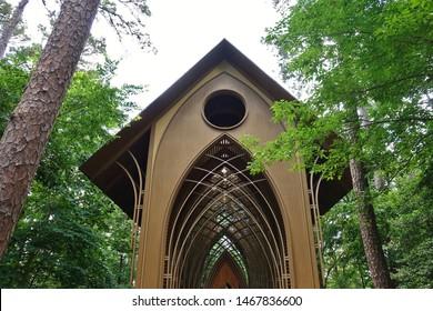 BELLA VISTA, ARKANSAS -28 JUN 2019- View of the Mildred B. Cooper Memorial Chapel, a landmark wooden chapel located along Lake Norwood in Bella Vista, Arkansas.