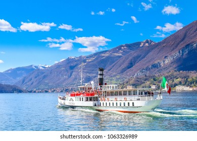 Bellagio , Italy - April 01, 2018: People are traveling by an old ferry, in Bellagio, Como Lake.