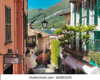 BELLAGIO, ITALY - MAY 5: Main street with background of lake Como and mountain in Bellagio, Italy on May 5, 2017