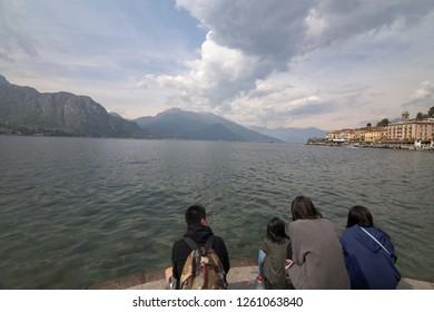 BELLAGIO LOMBARDY ITALY ON APRIL 2017: Family staring the lake in Bellaggio in Lago di Como lake in Lombardy Italy