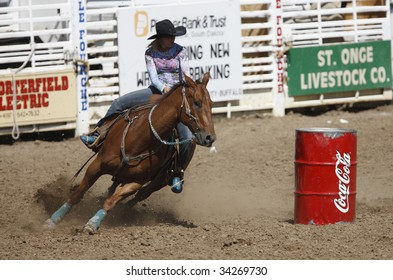 BELLE FOURCHE, SOUTH DAKOTA - JULY 4:  Barrel racing competition at the 90th annual Black Hills Roundup rodeo in Belle Fourche, South Dakota July 4, 2009.