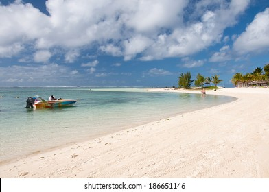BELLE MARE - JUNE 26: People relaxing on an beautiful beach on Maritius on June 26, 2013 in MAURITIUS.  Belle Mare, an exotic beach with white sand and nice lagoon, attracts a lot of  tourists