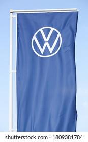 Belleville, France - August 23, 2020: New Volkswagen logo on a flag. Volkswagen is a German car manufacturer headquartered in Wolfsburg, Germany