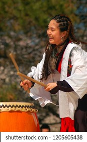 Belleville, NJ, USA April 21, 2007 A young adult demonstrates the art of traditional Japanese Taiko drumming at a festival in Belleville, New Jersey