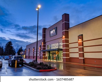 Bellevue, WA / USA - circa January 2020: Exterior view of a Dick's Sporting Goods store at night.
