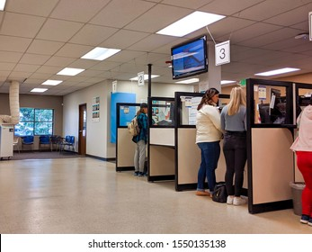 Bellevue, WA USA - November 1st, 2019: People renewing license ID at counter at the DMV in Bellevue, WA.