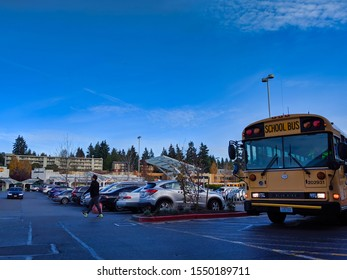 Bellevue, WA / USA - November 1st, 2019: Yellow school bus pulling through the parking lot of Uwajimaya and Total Wine and More on a sunny afternoon in Bellevue, WA.