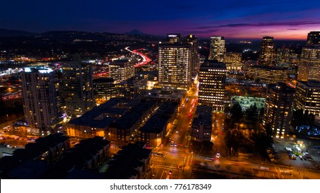 Bellevue Washington Aerial View at Night City Skyline Mount Rainier Background