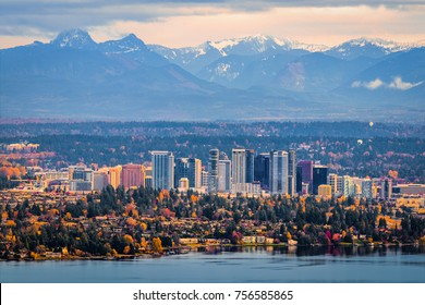 Bellevue Washington. The snowy Alpine Lakes Wilderness mountain peaks rise behind the urban skyline.