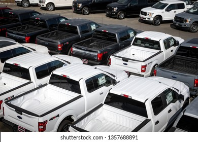 Bellevue, Washington / USA - April 1 2019:  Parking lot of F-150 pickup trucks, at a Ford dealership, in an American automaker background