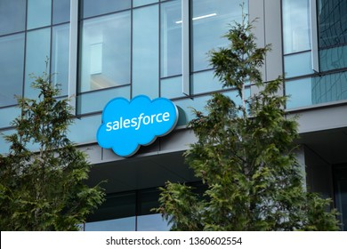 Bellevue, Washington / USA - April 2 2019:   Salesforce sign at the offices of the cloud computing and software company, framed by trees