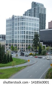 Bellevue, Washington / USA - April 25 2019: View over the Northeast 8th Street freeway offramp from Interstate 405 (I-405) in downtown Bellevue, with Microsoft skyscrapers is the distance