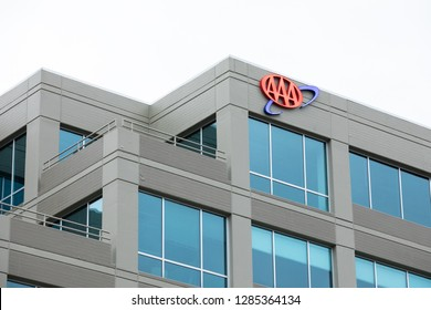 Bellevue, Washington / USA - January 3 2019: Logo for The American Automobile Association (AAA) on the exterior of a corporate office building