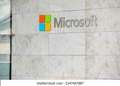 Bellevue, Washington / USA - July 11 2018: Side view on a Microsoft sign and logo on a gray stone wall with space for text on bottom