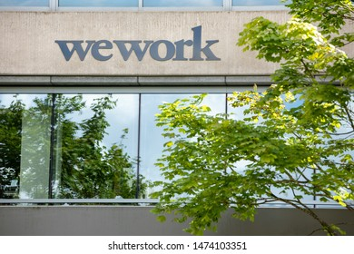 Bellevue, Washington / USA - July 11 2019: Wework sign for the shared office company, with space for text on bottom