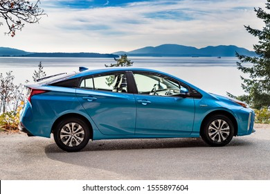Bellingham, WA USA - 11/09/2019: Toyota Prius Hybrid Auto with the Puget Sound in the Background