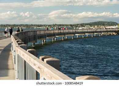 Bellingham, WA, USA - July 3, 2016:  Taylor Street Boardwalk on Bellingham Bay on a summer's evening.