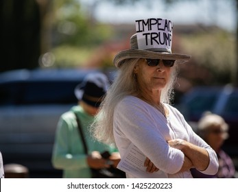 Bellingham, WA / USA - June 15, 2019: Protestors demonstrate to send a message to the US Congress to impeach President Donald Trump, joining thousands in similar events across the nation in protest