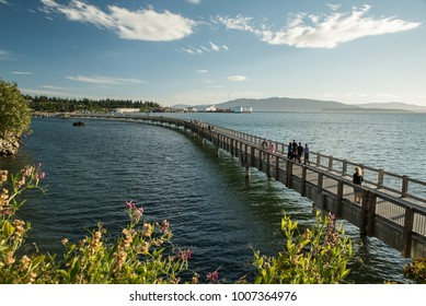 Bellingham, WA, USA.  Taylor Street Boardwalk on Bellingham Bay on a summer's evening.
