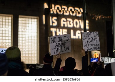 BELLINGHAM, WASHINGTON, USA - December 17, 2019: People holding signs in support of the impeachment of Donald Trump at a Nobody is Above the Law Impeachment Rally at City Hall.